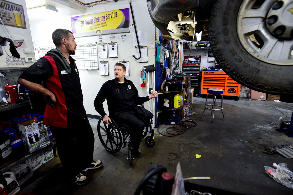 . LONGMONT, CO - FEBRUARY 4:Tom Maggio, right, talks with Technician Tim Holt, at Hands-On Auto Tech. near Longmont on Feb. 4, 2019. Maggio crashed into a tractor trailer on November 27th, 2018, and as a result of his injuries, had to have his leg amputated. (Photo by Matthew Jonas/Staff Photographer)