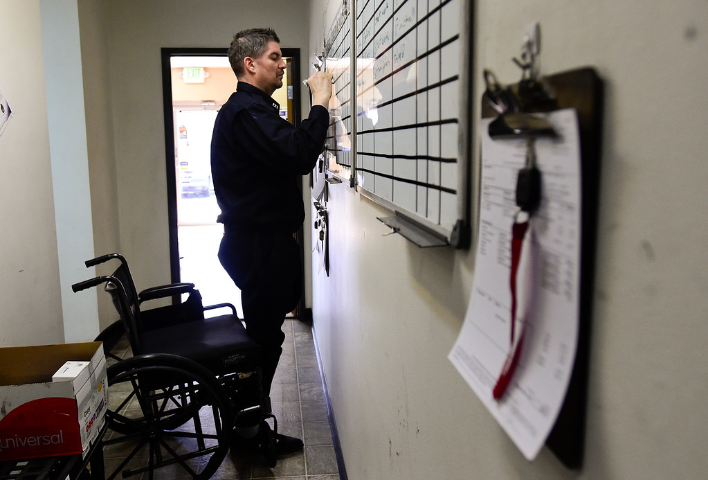 . LONGMONT, CO - FEBRUARY 4:Tom Maggio makes notes on a whiteboard to keep track of the vehicles in for service at Hands-On Auto Tech. near Longmont on Feb. 4, 2019. Maggio crashed into a tractor trailer on November 27th, 2018, and as a result of his injuries, had to have his leg amputated. (Photo by Matthew Jonas/Staff Photographer)