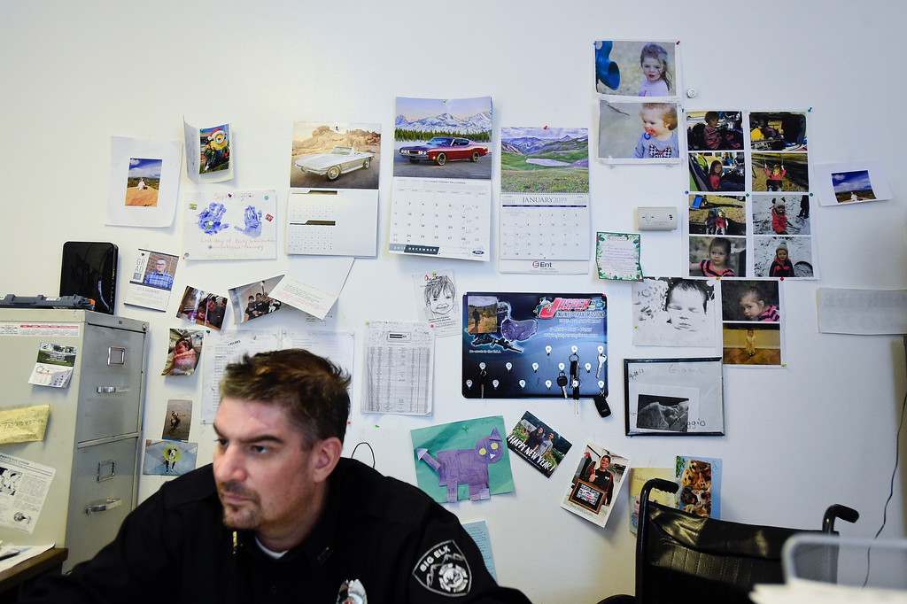 . LONGMONT, CO - FEBRUARY 4:Pictures, cards and letters from friends and family hang on the wall behind Tom Maggio as he works in the office at Hands-On Auto Tech. near Longmont on Feb. 4, 2019. Maggio crashed into a tractor trailer on November 27th, 2018, and as a result of his injuries, had to have his leg amputated. (Photo by Matthew Jonas/Staff Photographer)