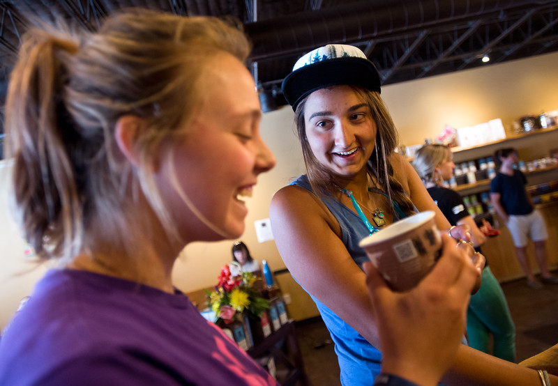 """Meena Fernald (right) shares a laugh with her friend Allie Aiello during a coffee tasting of Santa Ines, a Brazilian coffee, at Ozo Coffee on Friday afternoon. <br /> More photos:  <a href=""""http://www.dailycamera.com"""">http://www.dailycamera.com</a><br /> (Autumn Parry/Staff Photographer)<br /> July 29, 2016"""