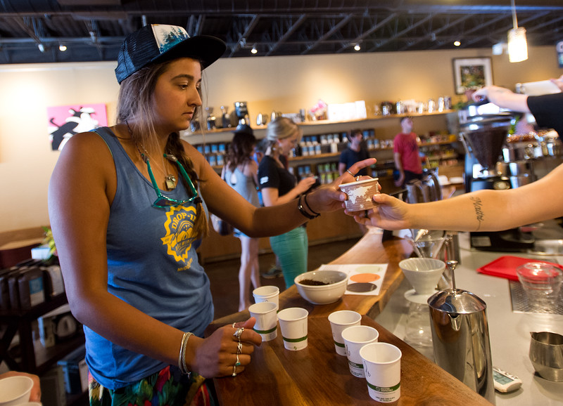 "Meena Fernald takes a cup of Santa Ines, a Brazilian coffee, during a tasting at Ozo Coffee on Friday afternoon. <br /> More photos:  <a href=""http://www.dailycamera.com"">http://www.dailycamera.com</a><br /> (Autumn Parry/Staff Photographer)<br /> July 29, 2016"