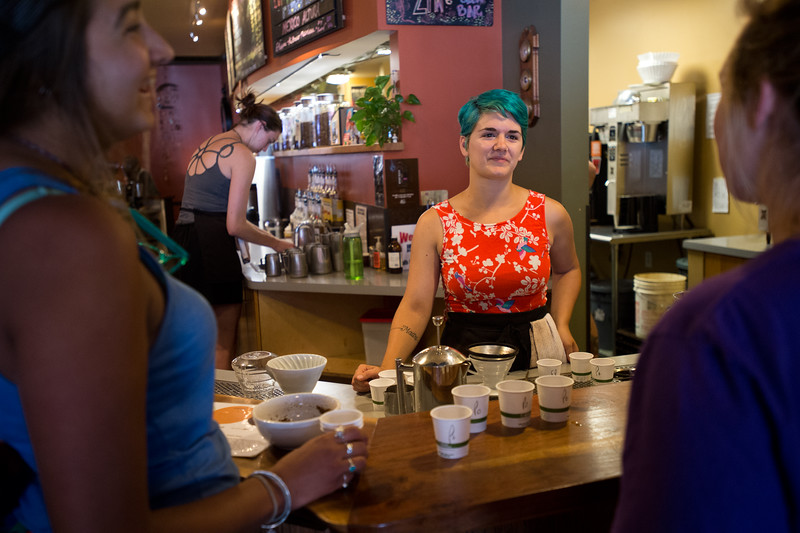 "Emily Melton, a barista, talks about how different methods of making coffee, such as using a french press, chemex, or pour over, yield different tasting coffees, at Ozo Coffee in Boulder on Friday.<br /> More photos:  <a href=""http://www.dailycamera.com"">http://www.dailycamera.com</a><br /> (Autumn Parry/Staff Photographer)<br /> July 29, 2016"