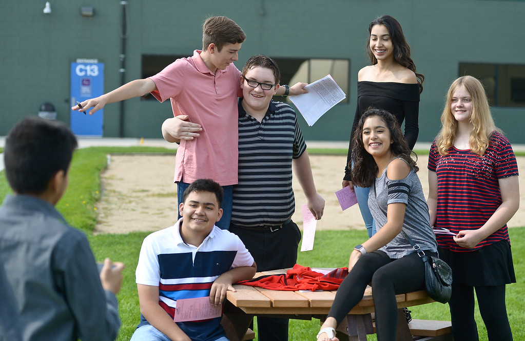 . From left: P-Tech student Jesus Aguilera photographs his classmates Bryan Carley, Alexander Cralley, Kaleb Allen, Esmeralda Enriquez, A\'Isha Fregoso and Taryn Caquelin in the courtyard Thursday morning at Front Range Community College, 2190 Miller Dr. To view more photos visit timescall.com. (Photo by Lewis Geyer/Staff Photographer) August 02, 2018