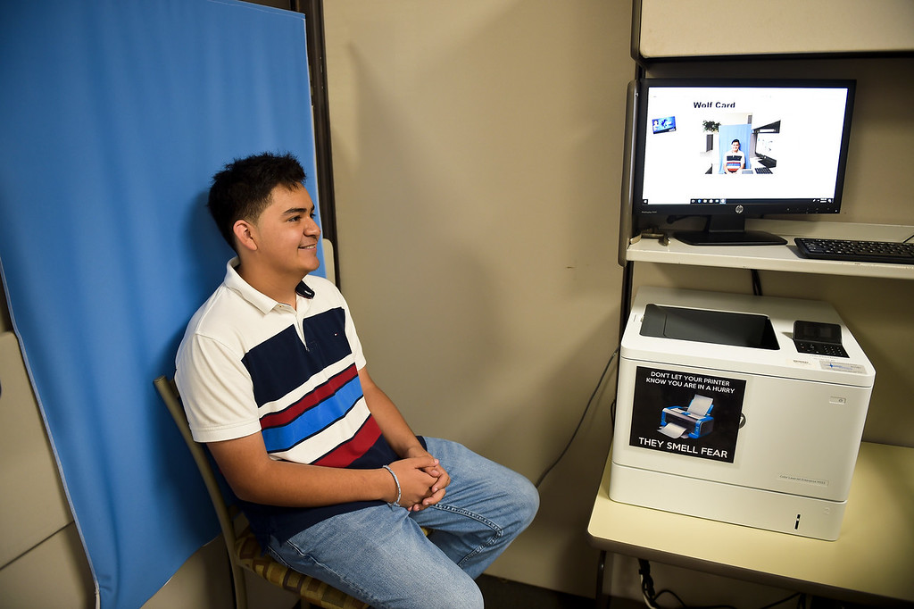 . P-Tech student Bryan Carley has his photo taken for his student ID Thursday morning at Front Range Community College, 2190 Miller Dr. To view more photos visit timescall.com. (Photo by Lewis Geyer/Staff Photographer) August 02, 2018