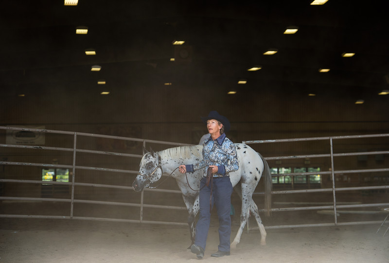 "Pam Klein walks with her pony, Dream, as they warm-up before a class with the POA Futurity and Open Horse Show at the Boulder County Fairgrounds in Longmont on Sunday.<br /> More photos:  <a href=""http://www.dailycamera.com"">http://www.dailycamera.com</a><br /> (Autumn Parry/Staff Photographer)<br /> August 28, 2016"