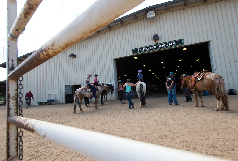 "Competitors line up outside of the arena as they await their turn to compete in the trail class during the POA Futurity and Open Horse Show at the Boulder County Fairgrounds in Longmont on Sunday.<br /> More photos:  <a href=""http://www.dailycamera.com"">http://www.dailycamera.com</a><br /> (Autumn Parry/Staff Photographer)<br /> August 28, 2016"