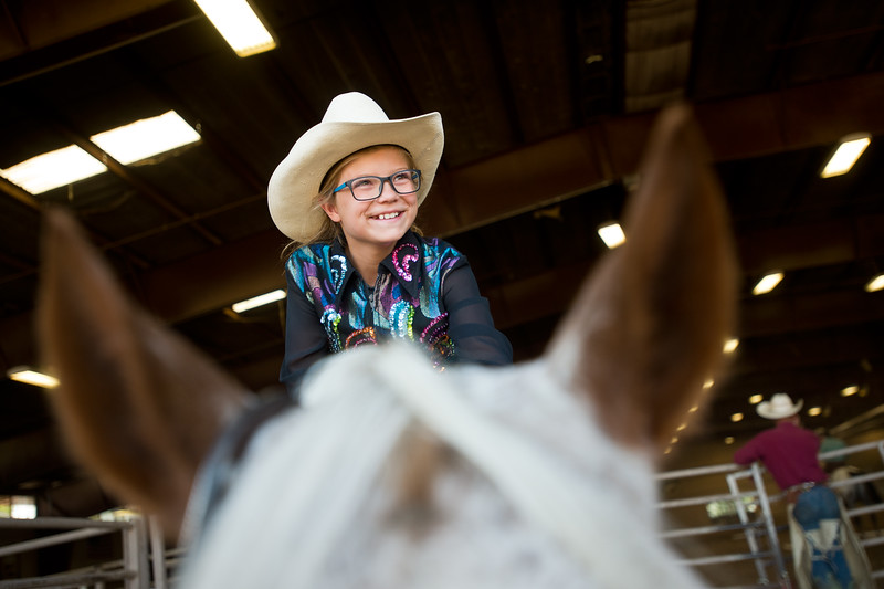 "Tait Miller, 10, pets her pony, Reba, after completing a trail class during the POA Futurity and Open Horse Show at the Boulder County Fairgrounds in Longmont on Sunday. <br /> More photos:  <a href=""http://www.dailycamera.com"">http://www.dailycamera.com</a><br /> (Autumn Parry/Staff Photographer)<br /> August 28, 2016"