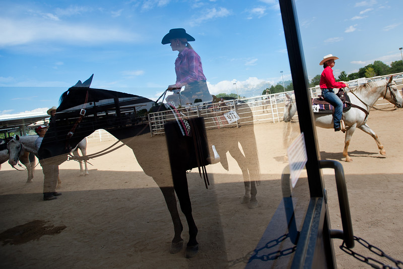 "Emma Widener (left) waits with her Quarter Horse, Coal, after completing a trail class during the POA Futurity and Open Horse Show at the Boulder County Fairgrounds in Longmont on Sunday.<br /> More photos:  <a href=""http://www.dailycamera.com"">http://www.dailycamera.com</a><br /> (Autumn Parry/Staff Photographer)<br /> August 28, 2016"
