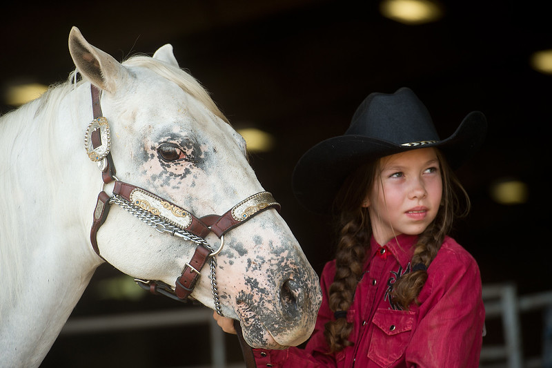 "Mya Keller, 10, waits with her pony, Impressive Kid, prior to the trail class during the POA Futurity and Open Horse Show at the Boulder County Fairgrounds in Longmont on Sunday.<br /> More photos:  <a href=""http://www.dailycamera.com"">http://www.dailycamera.com</a><br /> (Autumn Parry/Staff Photographer)<br /> August 28, 2016"
