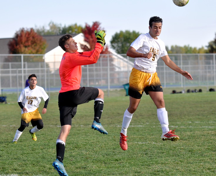 Thompson Valley's Pablo Cervantes (9) goes for a header against Mountain View on Oct. 3, 2017 at MVHS. (Cris Tiller / Loveland Reporter-Herald)