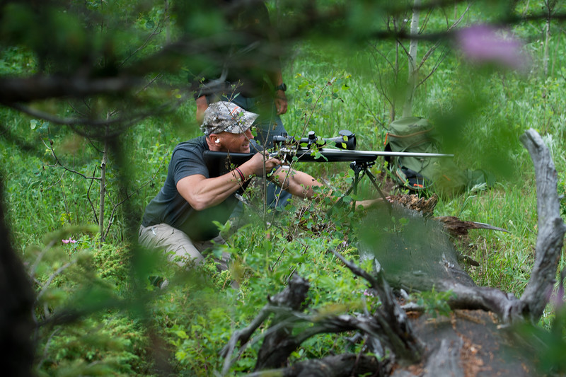 "Pastor Jim Burgen shoots during target practice with his friend Santino Castellanos near Pastor Burgen's home in Allenspark on Friday, July 1, 2016. <br /> More photos:  <a href=""http://www.dailycamera.com"">http://www.dailycamera.com</a><br /> (Autumn Parry/Staff Photographer)<br /> July 1, 2016"