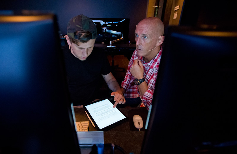 "Pastor Jim Burgen goes over changes to biblical slides with his son Jordan Burgen, the creative director at the church, after a dress rehearsal for the weekend's service at Flatirons Community Church in Lafayette on Saturday, June 25, 2016.<br /> More photos:  <a href=""http://www.dailycamera.com"">http://www.dailycamera.com</a><br /> (Autumn Parry/Staff Photographer)<br /> June 25, 2016"