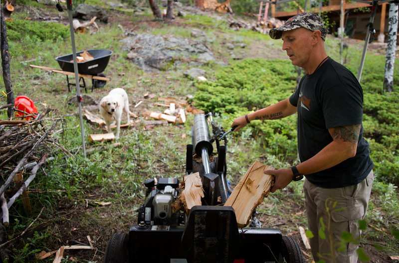"Pastor Jim Burgen uses a log splitter to cut wood outside of his home in Allenspark on Friday, July 1, 2016. <br /> More photos:  <a href=""http://www.dailycamera.com"">http://www.dailycamera.com</a><br /> (Autumn Parry/Staff Photographer)<br /> July 1, 2016"