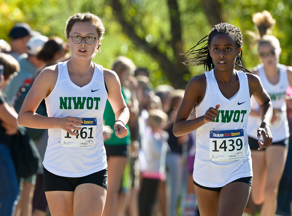 . BOULDER, CO - SEPTEMBER 22, 2018: Niwot\'s Maggie Smith, left, and Samrawit Dishon race together during the Pat Patten Cross Country Invitational Sept. 22 in Boulder. (Photo by Lewis Geyer/Staff Photographer)