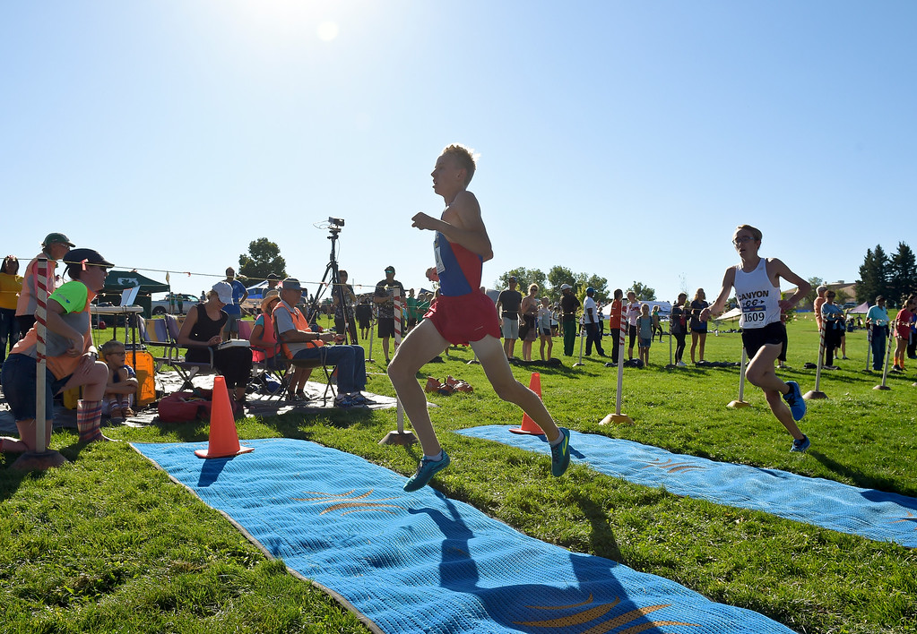. BOULDER, CO - SEPTEMBER 22, 2018: Centaurus\' Cooper Brown crosses the finish line in front of Rock Canyon\'s Derek Fearon at the Pat Patten Cross Country Invitational Sept. 22 in Boulder. (Photo by Lewis Geyer/Staff Photographer)