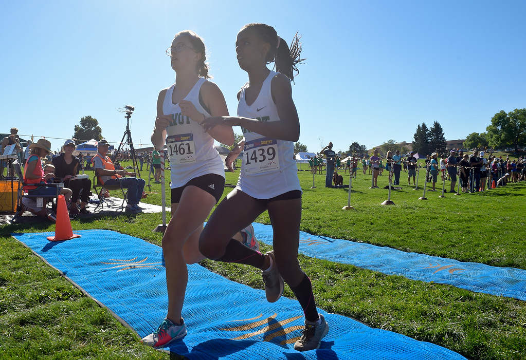 . BOULDER, CO - SEPTEMBER 22, 2018: Niwot\'s Maggie Smith finishes in first place in front of teammate Samrawit Dishon at the Pat Patten Cross Country Invitational Sept. 22 in Boulder. (Photo by Lewis Geyer/Staff Photographer)