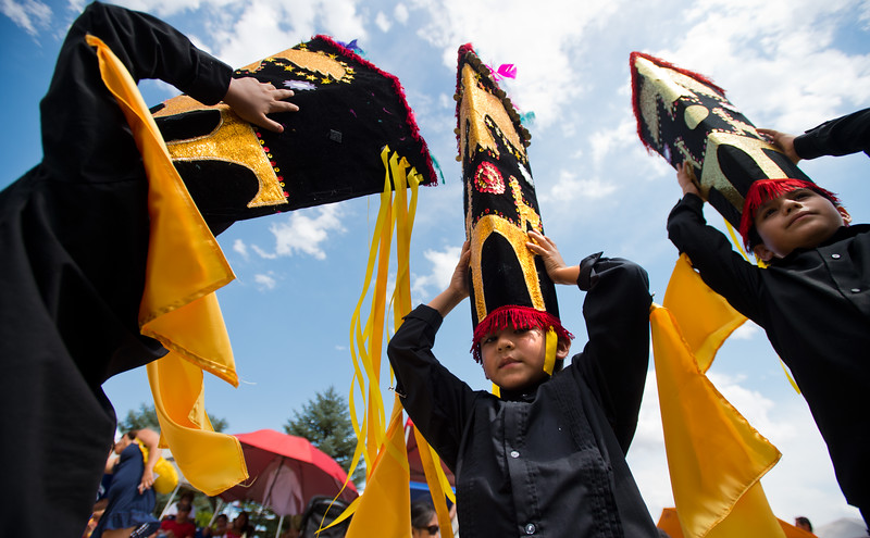 "Junior Lopez, 9, (center) holds his hat tightly as he waits to dance with Qhaswa Peru, a Peruvian folk dance group, during the Peruvian Festival at Sandstone Ranch Park in Longmont on Sunday.<br /> More photos:  <a href=""http://www.dailycamera.com"">http://www.dailycamera.com</a><br /> (Autumn Parry/Staff Photographer)<br /> July 24, 2016"