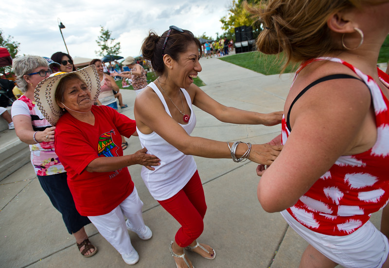 "Elizabeth Pinedo (center) dances with visitors during the Peruvian Festival at Sandstone Ranch Park in Longmont on Sunday.<br /> More photos:  <a href=""http://www.dailycamera.com"">http://www.dailycamera.com</a><br /> (Autumn Parry/Staff Photographer)<br /> July 24, 2016"