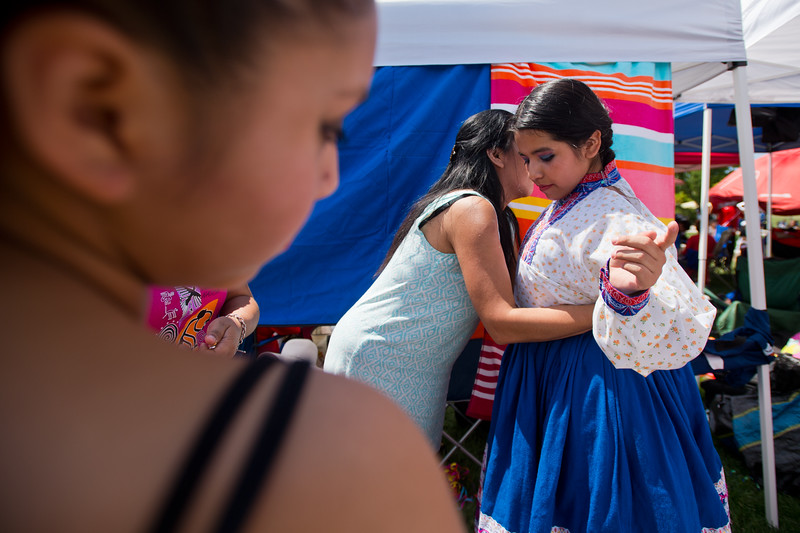 "Lexdee Garay (left) helps her daughter, Maria Sanchez, adjust her attire as she prepares to dance with Qhaswa Peru during the Peruvian Festival at Sandstone Ranch Park in Longmont on Sunday.<br /> More photos:  <a href=""http://www.dailycamera.com"">http://www.dailycamera.com</a><br /> (Autumn Parry/Staff Photographer)<br /> July 24, 2016"