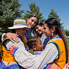 "Members of Qhaswa Peru, a Peruvian folk dance group, share a hug before their performance at the Peruvian Festival at Sandstone Ranch Park in Longmont on Sunday.<br /> More photos:  <a href=""http://www.dailycamera.com"">http://www.dailycamera.com</a><br /> (Autumn Parry/Staff Photographer)<br /> July 24, 2016"