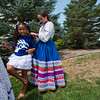 "Jamilah Gil Morales, 6, holds still as Makayla Nalley, 9, braids her hair during the Peruvian Festival at Sandstone Ranch Park in Longmont on Sunday.<br /> More photos:  <a href=""http://www.dailycamera.com"">http://www.dailycamera.com</a><br /> (Autumn Parry/Staff Photographer)<br /> July 24, 2016"