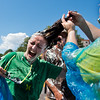 """Brittany Norris tries to hold still Saturday as her mom, Kelley Norris, removes whip cream from her hair after the pie fight in Longmont. The Twin Peaks Rotary Club held a pie fight to raise money for St. Vrain Valley School District Rotary Youth Programs.  <br /> More photos:  <a href=""""http://www.dailycamera.com"""">http://www.dailycamera.com</a><br /> (Autumn Parry/Staff Photographer)<br /> August 27, 2016"""