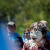 """Micah Cromwell laughs after he was hit in the face with a whipping cream pie after a pie fight in Longmont on Saturday. <br /> More photos:  <a href=""""http://www.dailycamera.com"""">http://www.dailycamera.com</a><br /> (Autumn Parry/Staff Photographer)<br /> August 27, 2016"""