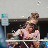 "Skylar Reynolds throws a whipping cream pie during the pie fight in Longmont on Saturday. <br /> More photos:  <a href=""http://www.dailycamera.com"">http://www.dailycamera.com</a><br /> (Autumn Parry/Staff Photographer)<br /> August 27, 2016"