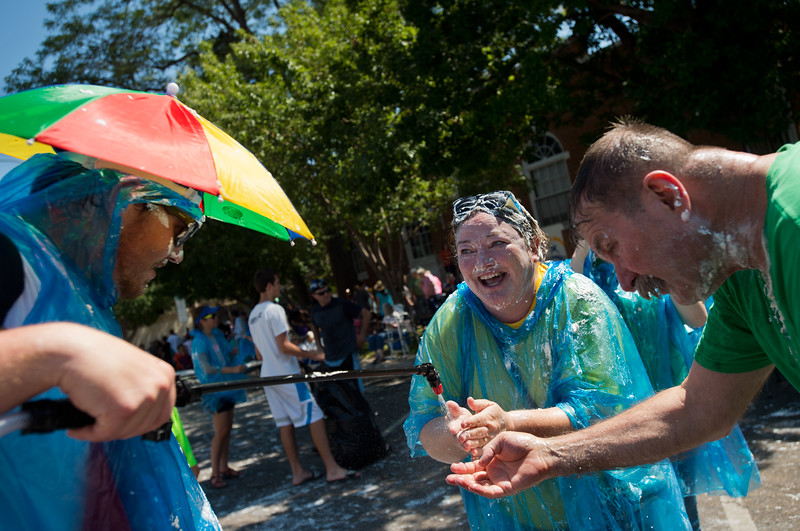 "Kelley Norris (center) washes whipping cream off her hands after the pie fight in Longmont on Saturday. <br /> More photos:  <a href=""http://www.dailycamera.com"">http://www.dailycamera.com</a><br /> (Autumn Parry/Staff Photographer)<br /> August 27, 2016"