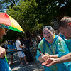 """Kelley Norris (center) washes whipping cream off her hands after the pie fight in Longmont on Saturday. <br /> More photos:  <a href=""""http://www.dailycamera.com"""">http://www.dailycamera.com</a><br /> (Autumn Parry/Staff Photographer)<br /> August 27, 2016"""