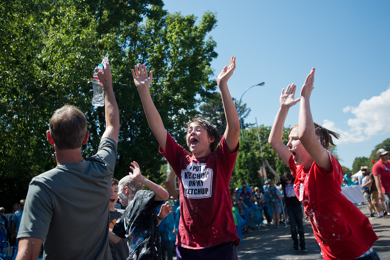 "Micah Cromwell (center) celebrates after his team was dubbed the winners of the pie fight, in Longmont on Saturday. <br /> More photos:  <a href=""http://www.dailycamera.com"">http://www.dailycamera.com</a><br /> (Autumn Parry/Staff Photographer)<br /> August 27, 2016"