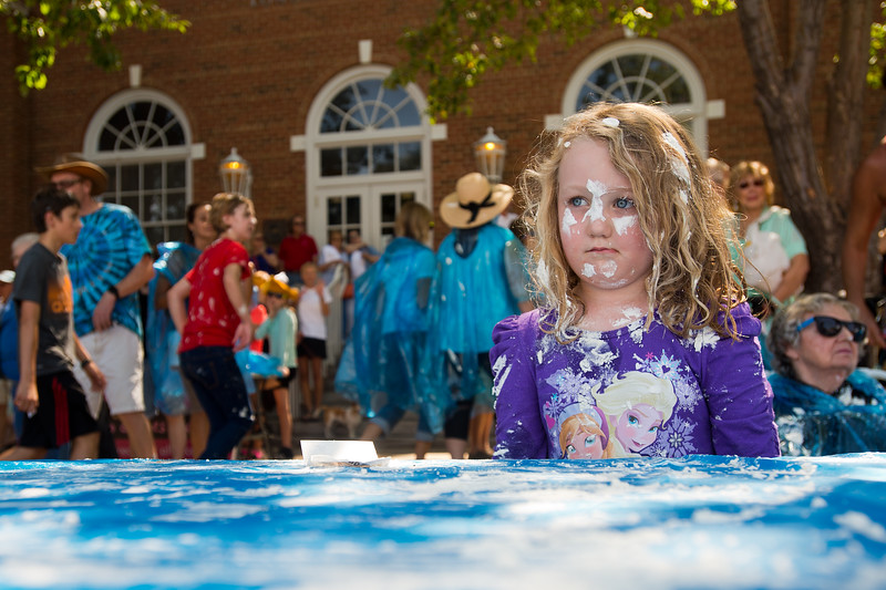 "Olive McElroy, 5, was hit with whipping cream as she watched the pie fight in Longmont on Saturday. <br /> More photos:  <a href=""http://www.dailycamera.com"">http://www.dailycamera.com</a><br /> (Autumn Parry/Staff Photographer)<br /> August 27, 2016"