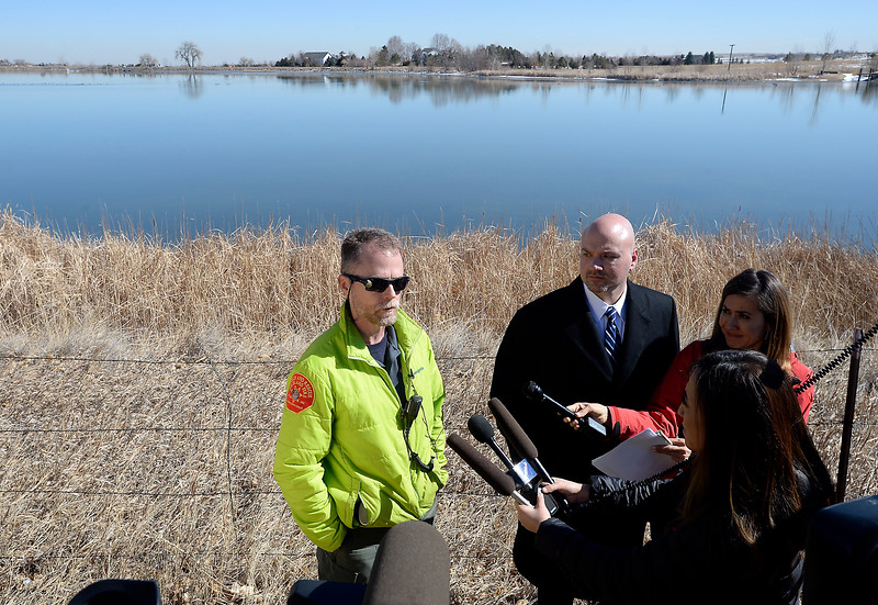 Derek Rosenquist, left, with the Larimer Sheriff's office emergency services, and David Moore, withthe Larimer County Sheriff Department, talk Monday morning, Feb. 27, 2017, about a plane that crashed into Culver Reservoir southwest of Berthoud. Two males who were pulled from the plane were prononced dead at the hospital. (photo by Jenny Sparks/Loveland Reporter-Herald)