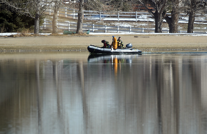 Divers look for debris Monday morning, Feb. 27, 2017, from a plane that crashed into Culver Reservoir southwest of Berthoud. Two males who were pulled from the plane were prononced dead. (photo by Jenny Sparks/Loveland Reporter-Herald)