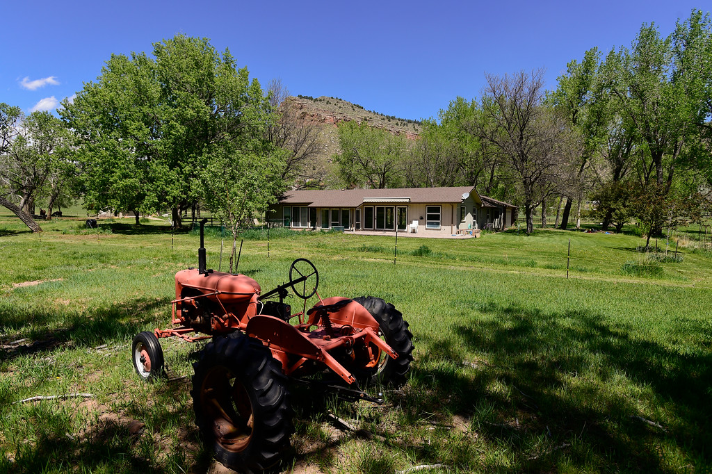 . An old tractor sits in a pasture next to a private residence across from Planet Bluegrass in Lyons on Monday. The pasture could be used for festival parking. Planet Bluegrass has submitted a letter of intent which states that they plan on using a piece of property to the west of Planet Bluegrass Ranch as farmland, but also as a place for up to 1,200 people attending larger festivals like the Folks Festival and RockyGrass to camp out and park. More photos: DailyCamera.com. Matthew Jonas/Staff Photographer May 15,  2017