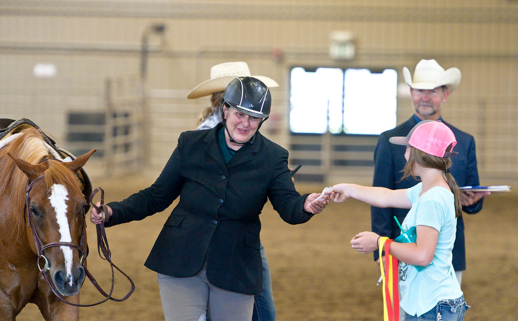 . Jeanette Krueger, 61, takes a fourth place ribbon during the 2018 Rocky Mountain Regional and West World Pony of the Americas horse show Sunday at the Boulder County Fairgrounds. Krueger said she once broke her back and pelvis when she fell off her horse during the same show about 10 years ago but still had to drive herself and her ponies back to their Montana home. To view more photos visit timescall.com. Lewis Geyer/Staff Photographer July 08, 2018