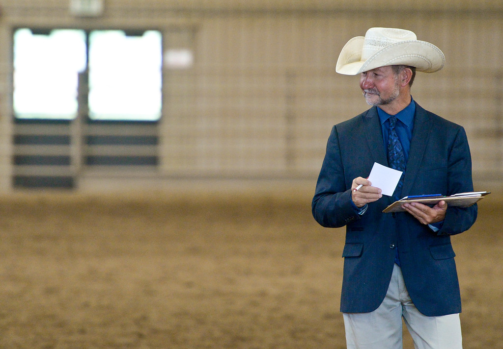 . Don Beard, of Cheyenne, judges horses and their riders during the 2018 Rocky Mountain Regional and West World Pony of the Americas horse show Sunday at the Boulder County Fairgrounds. To view more photos visit timescall.com. Lewis Geyer/Staff Photographer July 08, 2018