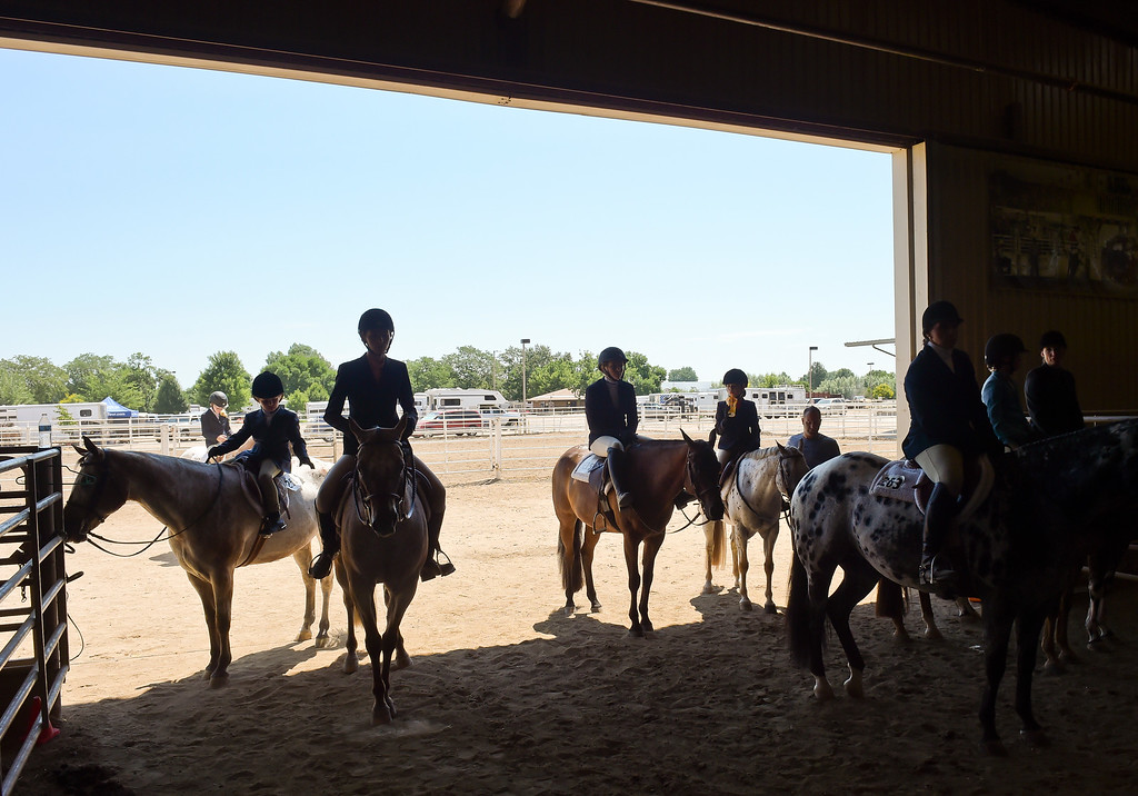 . Participants try to stay in the shade of the Indoor Arena during the 2018 Rocky Mountain Regional and West World Pony of the Americas horse show Sunday at the Boulder County Fairgrounds. To view more photos visit timescall.com. Lewis Geyer/Staff Photographer July 08, 2018