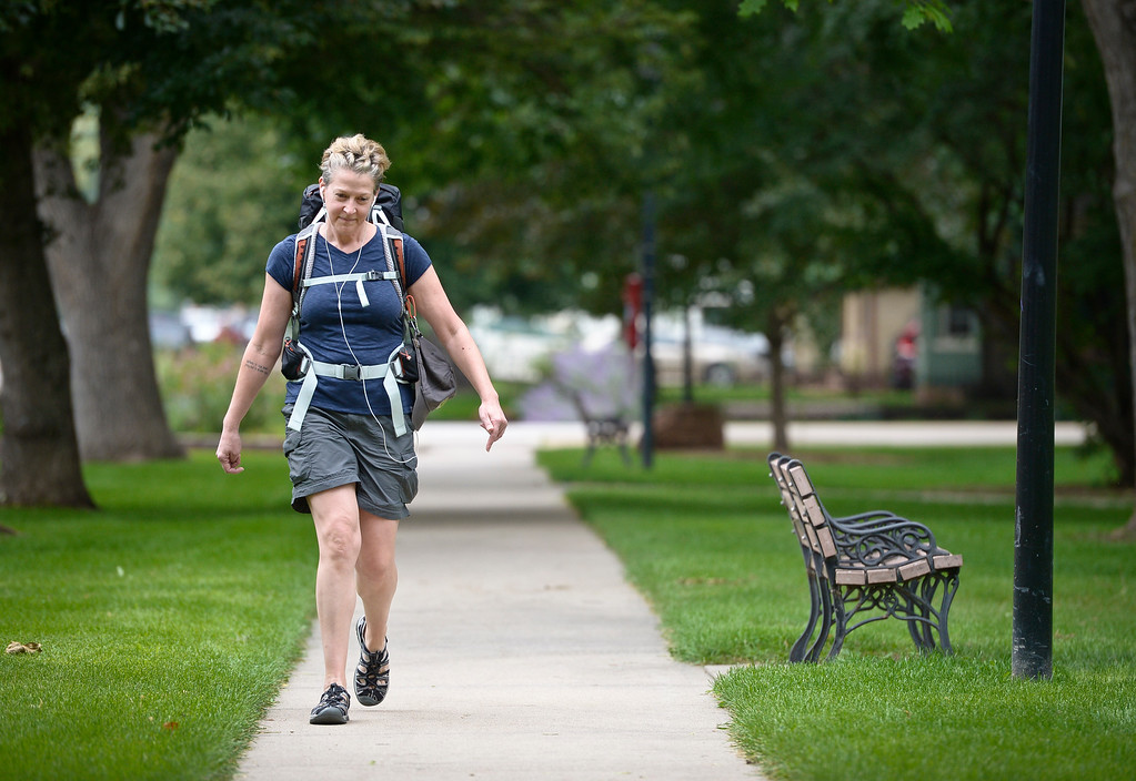 . LONGMONT, CO - AUG. 8: Jane Hanlon hikes along Sixth Avenue at Collyer Park Aug. 8 in preparation for a 500-mile hike she will be doing in Spain. Hanlon and her father had planned to do the hike together but he died in a motorcycle accident last year. To view more photos visit timescall.com. (Photo by Lewis Geyer/Staff Photographer)