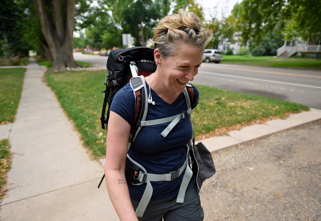 . LONGMONT, CO - AUG. 8: Jane Hanlon walks with a backpack along Fourth Avenue Aug. 8 in preparation for a 500-mile hike she will be doing in Spain. Hanlon and her father had planned to do the hike together but he died in a motorcycle accident last year. To view more photos visit timescall.com. (Photo by Lewis Geyer/Staff Photographer)