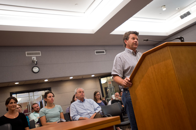 """Boulder resident Chuck Wibby argues against extending collections of a sales and use tax which would help fund open space acquisition and sustainability programs, during a public hearing held by the county commissioners, at the Boulder County Courthouse on Thursday.<br /> More photos:  <a href=""""http://www.dailycamera.com"""">http://www.dailycamera.com</a><br /> (Autumn Parry/Staff Photographer)<br /> July 28, 2016"""