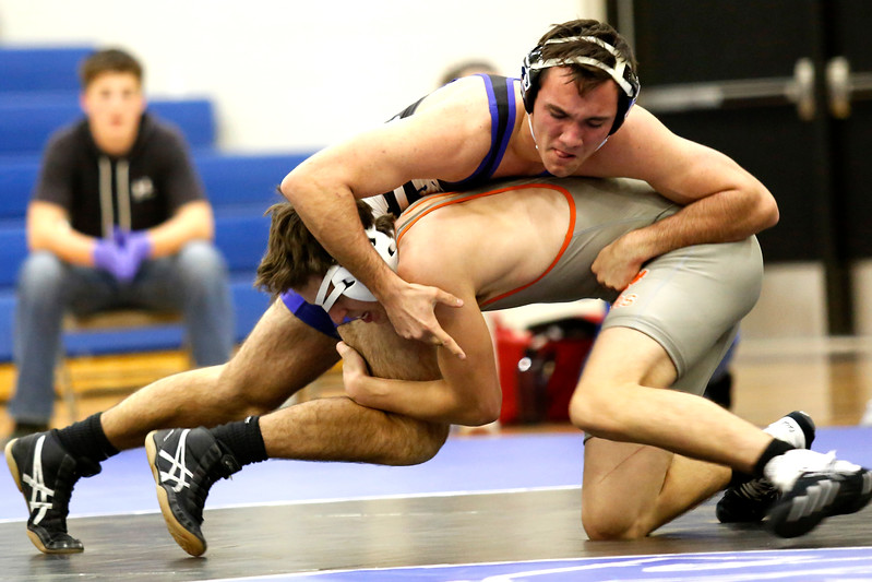 Resurrection's Cameron Stahla tries to take down Sterling's Tristan Lambrecht before he goes down during their 145 weight class match on Thursday, Dec. 7, 2017, at RCS in Loveland. (Photo by Lauren Cordova/Loveland Reporter-Herald)