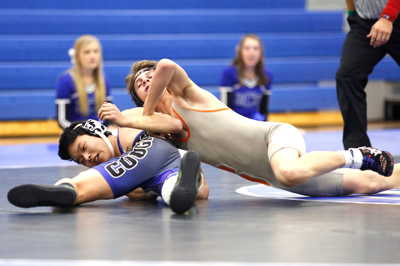 Resurrection's Jung Jae Lee is overthrown by Sterling's Logan Bohler during their 120 weight class match on Thursday, Dec. 7, 2017, at RCS in Loveland. (Photo by Lauren Cordova/Loveland Reporter-Herald)