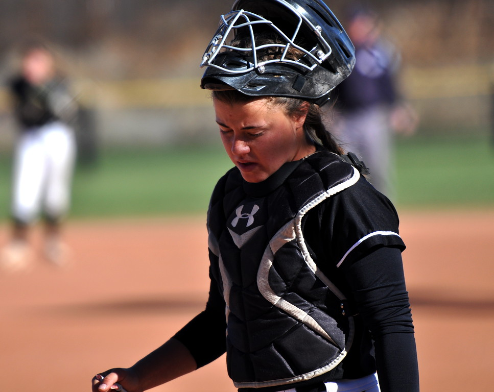 . Mountian View catcher Kaley Barker looks down after a hit Saturday at the state championships in Aurora. (Cris Tiller / Loveland Reporter-Herald)