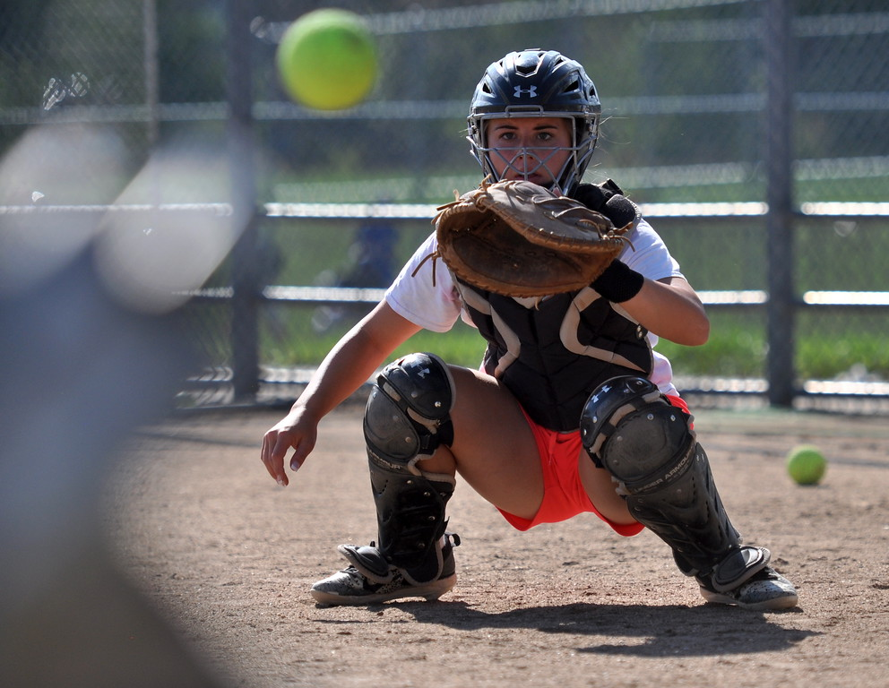 . Mountain View catcher Kaley Barker eyes a pitch during practice Thursday Aug. 17, 2017 at MVHS. (Cris Tiller / Loveland Reporter-Herald)