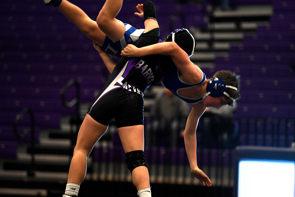 . LOVELAND, CO FEBRUARY 03: Kaley Barker lifts Eric Wagner from Longmont High School during their 113 pound match at Mountain View High School.  Barker won this match 11-3 February 03, 2017 Loveland, CO. (Photo By Joe Amon/The Denver Post)