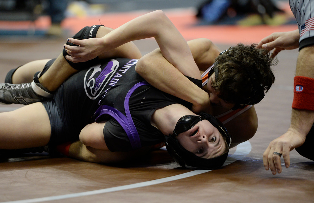 . DENVER, CO - February 18: Mountain View wrestler Kaley Barker, bottom, wrestles Ben Euresti, Greeley Central, during their 4A 106lb preliminary match at the 2016 Colorado State Wrestling Championships at the Pepsi Center February 18, 2016. Barker lost the match. (Photo by Andy Cross/The Denver Post)