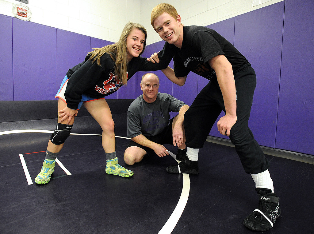 . 0113 SPO MV WrestleCoach-js.jpg Mountain View High School wrestling coach Scott Barker, center, poses for a photo Monday, Jan. 12, 2015, with his twins, Kaley, left, and Brendan, in the wrestling room at MVHS in Loveland. (Photo by Jenny Sparks/Loveland Reporter-Herald)