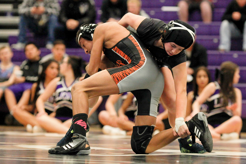 . Kaley Barker, right, sophomore at Mountain View, grabs ahold of Greeley Central\'s Julian Vasquez during their 113 pound match on Thursday, Dec. 3, 2015 in Loveland. (Photo by Trevor L. Davis/Loveland Reporter-Herald)
