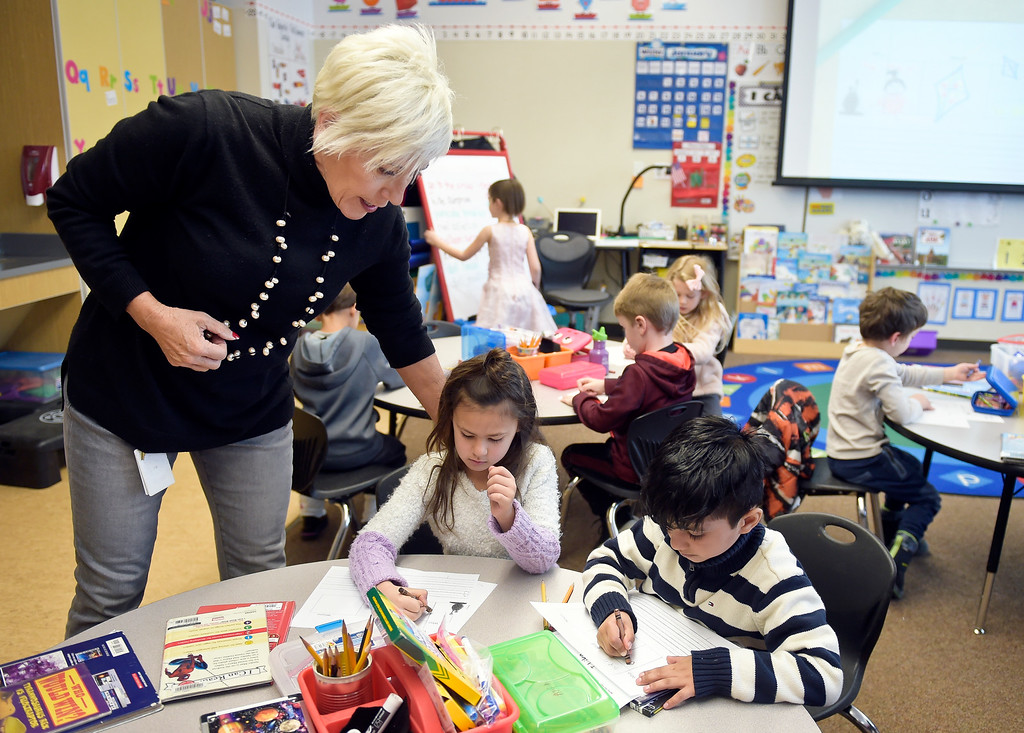 . ERIE, CO - JANUARY 24: Teacher Renee Quijas checks on kindergartners Eva Jimenez, center, and Ayush Gaur in her full-day kindergarten class at Erie\'s Red Hawk Elementary January 24, 2019. Red Hawk has three classrooms for full-day kindergarten. To view more photos visit timescall.com. (Photo by Lewis Geyer/Staff Photographer)